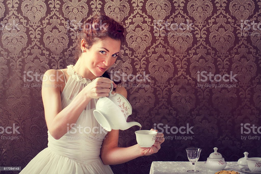 dreamer woman drinking tea at tea time stock photo