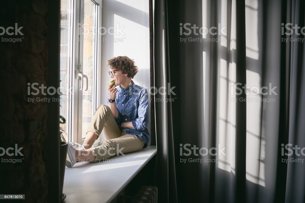Dreamful woman with apple stock photo