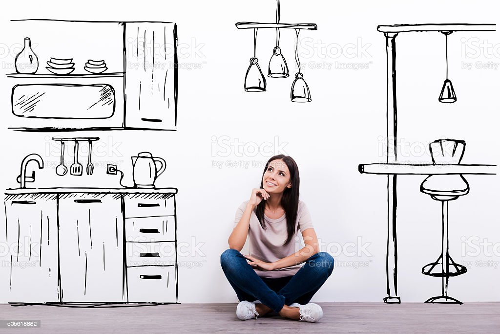 Dreaming about new kitchen. stock photo