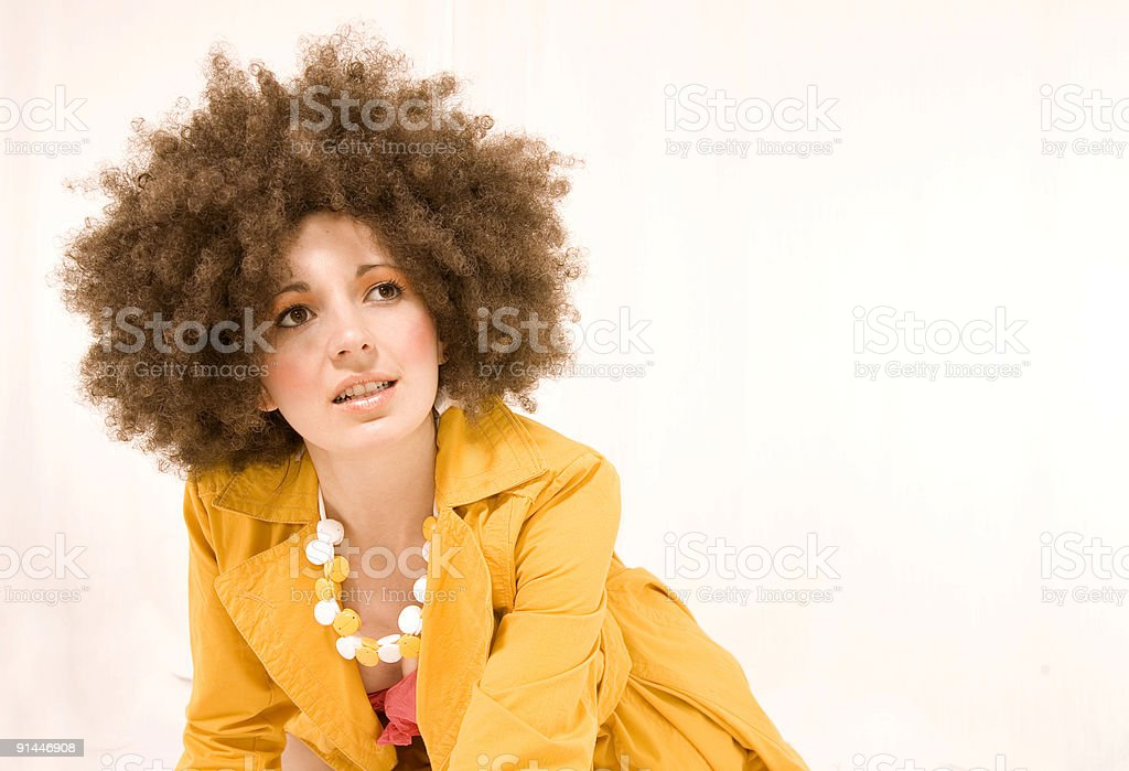Dreaming girl with curly hairs royalty-free stock photo