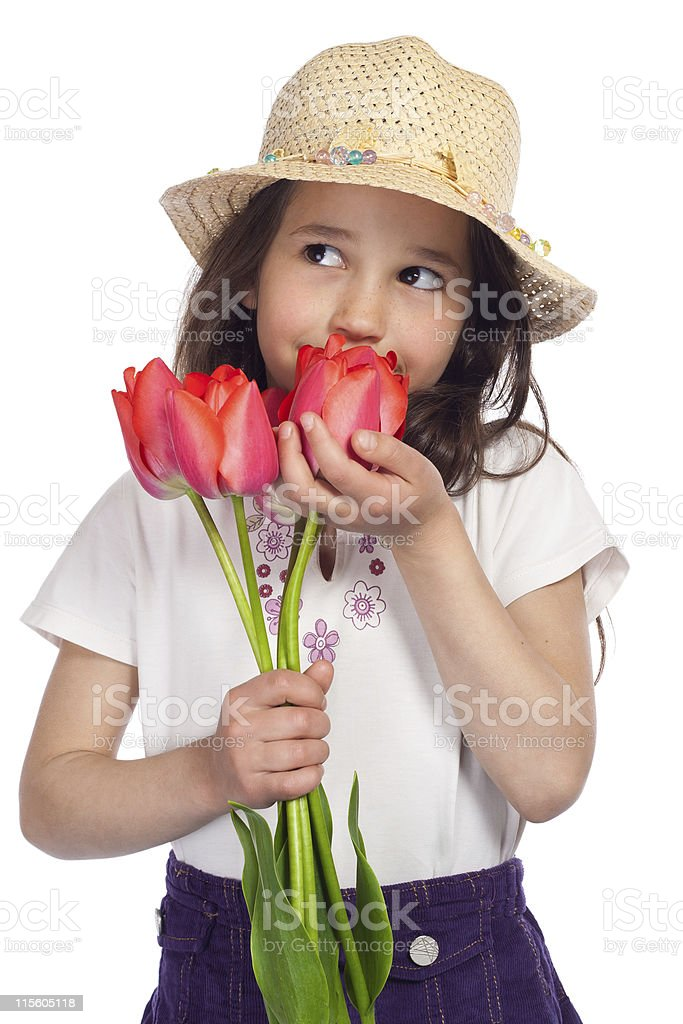 Dreaming little girl with red tulips royalty-free stock photo