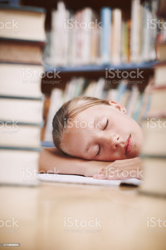 Dreaming of the stories she's read royalty-free stock photo