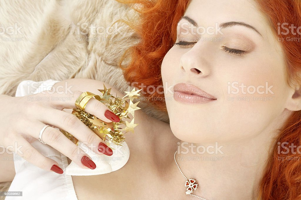 dreaming redhead with white christmas bells royalty-free stock photo