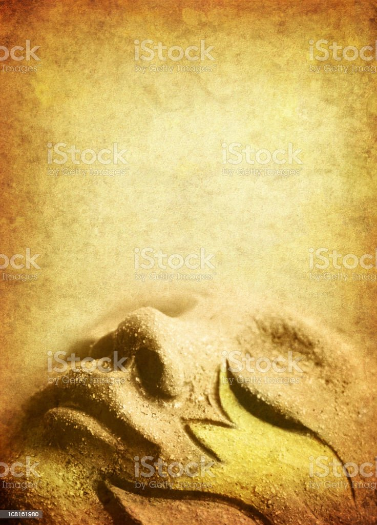 dreaming stone face on old paper royalty-free stock photo