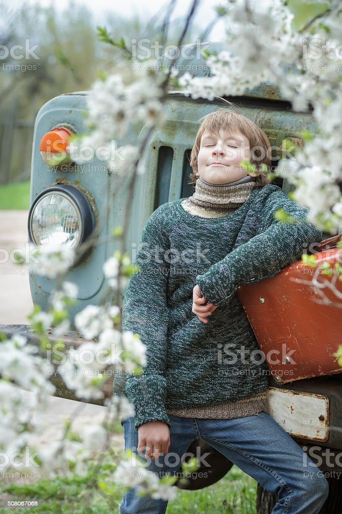Dreaming teenager with closed eyes wearing knitted melange sweater stock photo