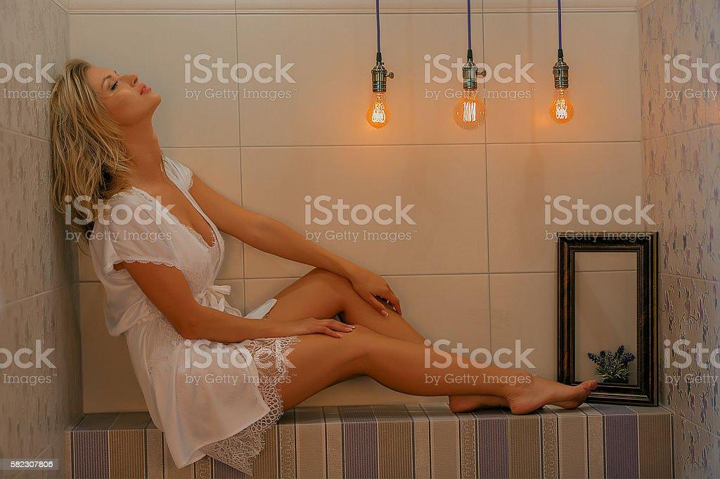 Dreaming woman. Interior shot stock photo