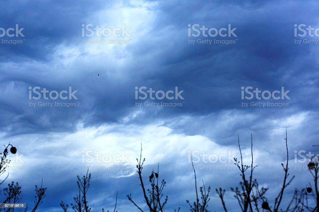 Dreamlike Sky dark clouds: Dramatic sad storm cloudscape, spooky landscape stock photo