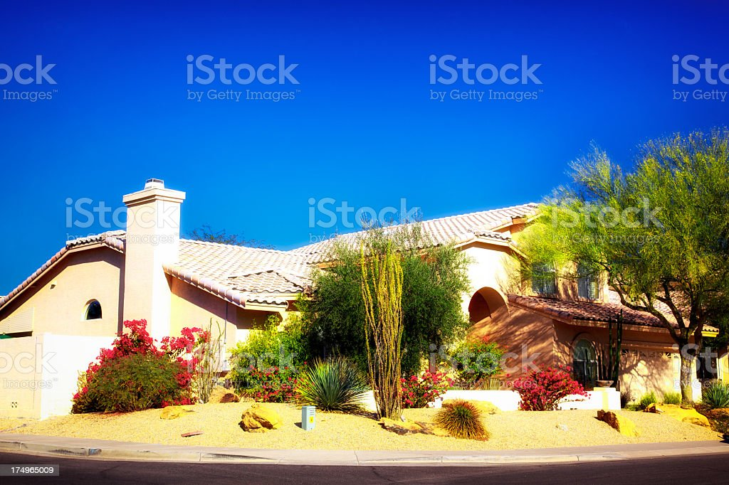 Dreamy Beautiful Tiled Roof Mission Style Desert Landscaped stock photo