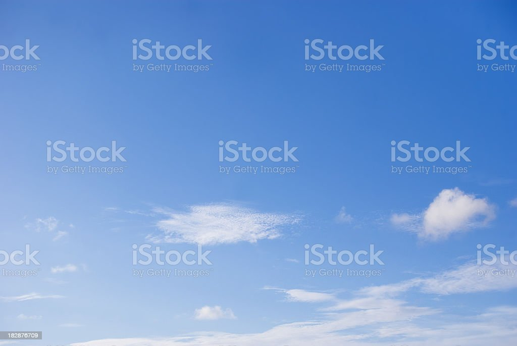 dreamy blue sky and wispy clouds stock photo