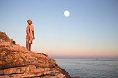 dreamy boy admires enchanted moon in the sky