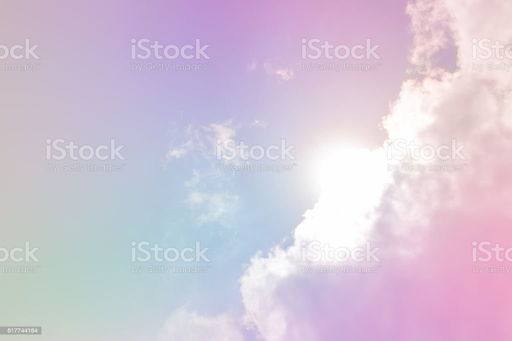 Dreamy filter : Blue sky with sun behind big cloud stock photo