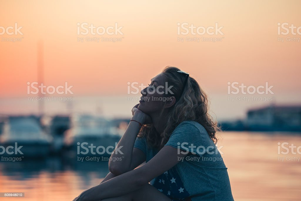 Dreamy girl at the yacht port stock photo
