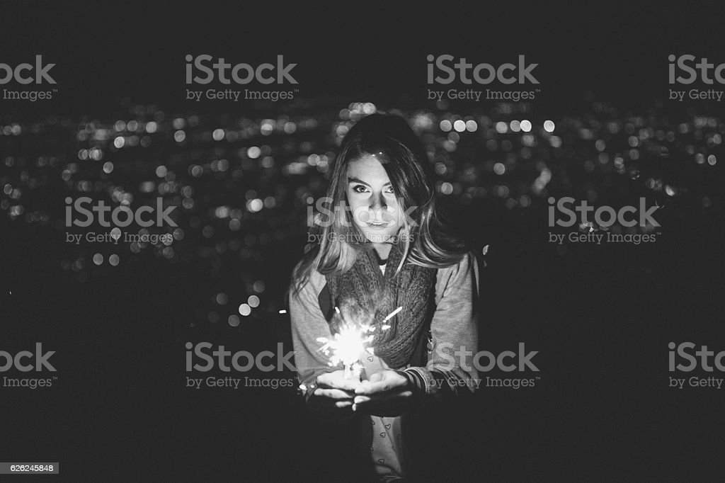 Dreamy girl celebrating New Year on the rooftop stock photo
