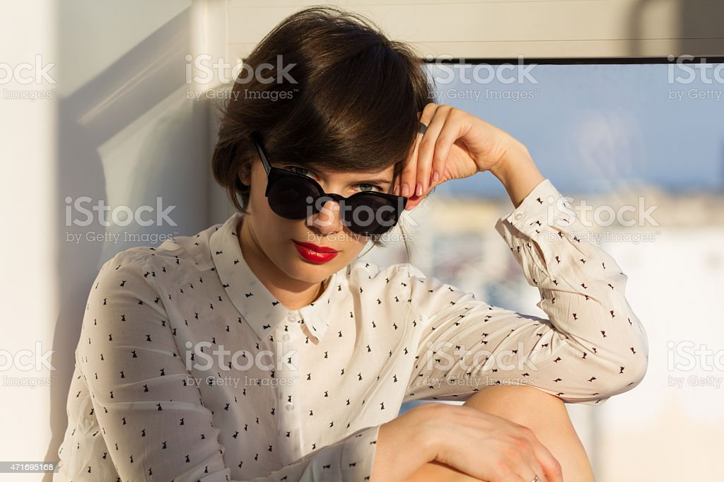 Dreamy girl near the window stock photo
