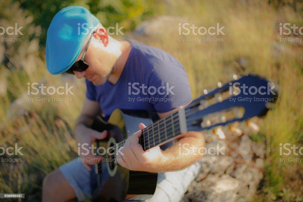 Dreamy image of guitarist stock photo