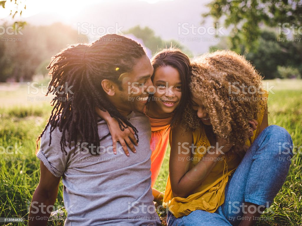 Dreamy moment between a father and his daughter and wife stock photo