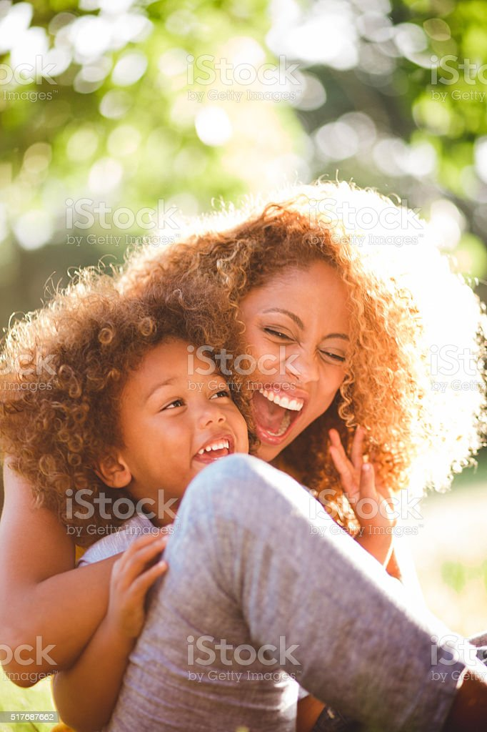 Dreamy soft intimate moment between mother and her boy stock photo