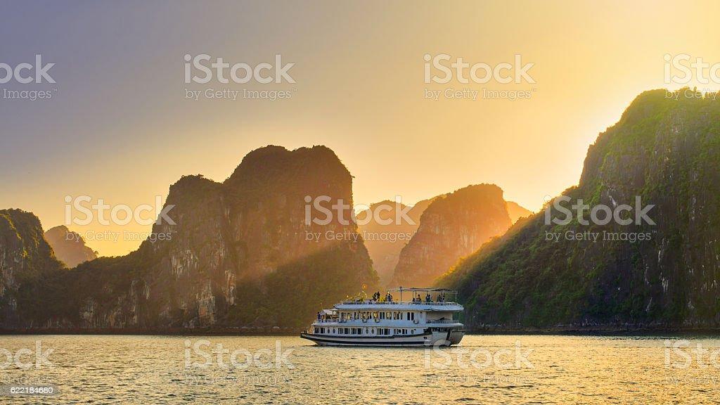 Dreamy sunset among the rocks of Halong Bay, Vietnam stock photo