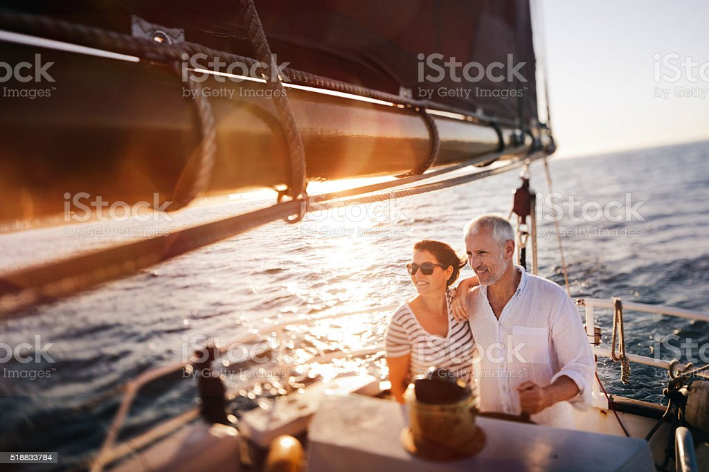 Dreamy vintage shot of senior couple enjoying a leasure cruise stock photo
