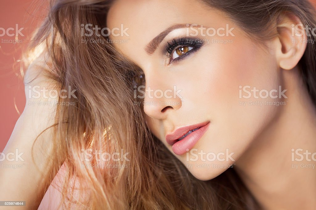 Dreamy Woman Over Pink stock photo