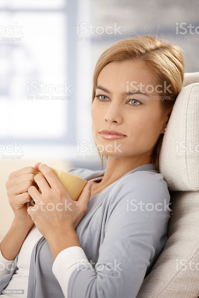 Dreamy woman with tea mug royalty-free stock photo
