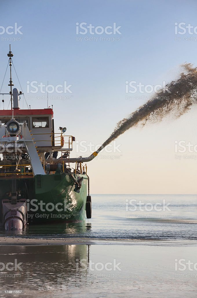 Dredge and jet of sand royalty-free stock photo