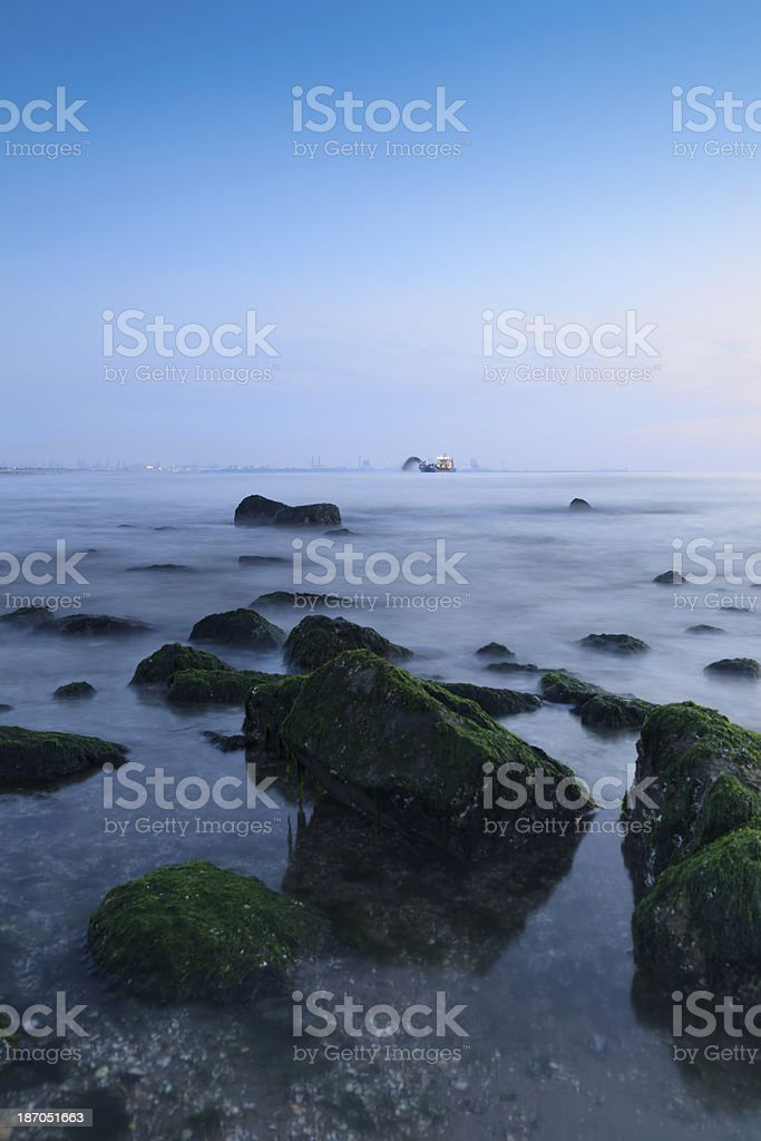 dredger pumping sand onto the coastline royalty-free stock photo