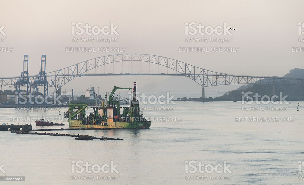 Dredging Operation with Bridge of the Americas royalty-free stock photo