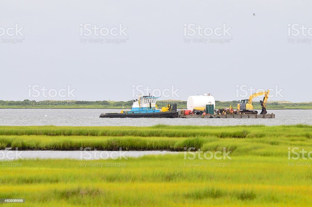 Dredging Sinepuxent Bay stock photo