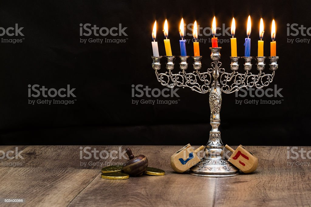 Dreidels and a menorah. Hanukkah stock photo