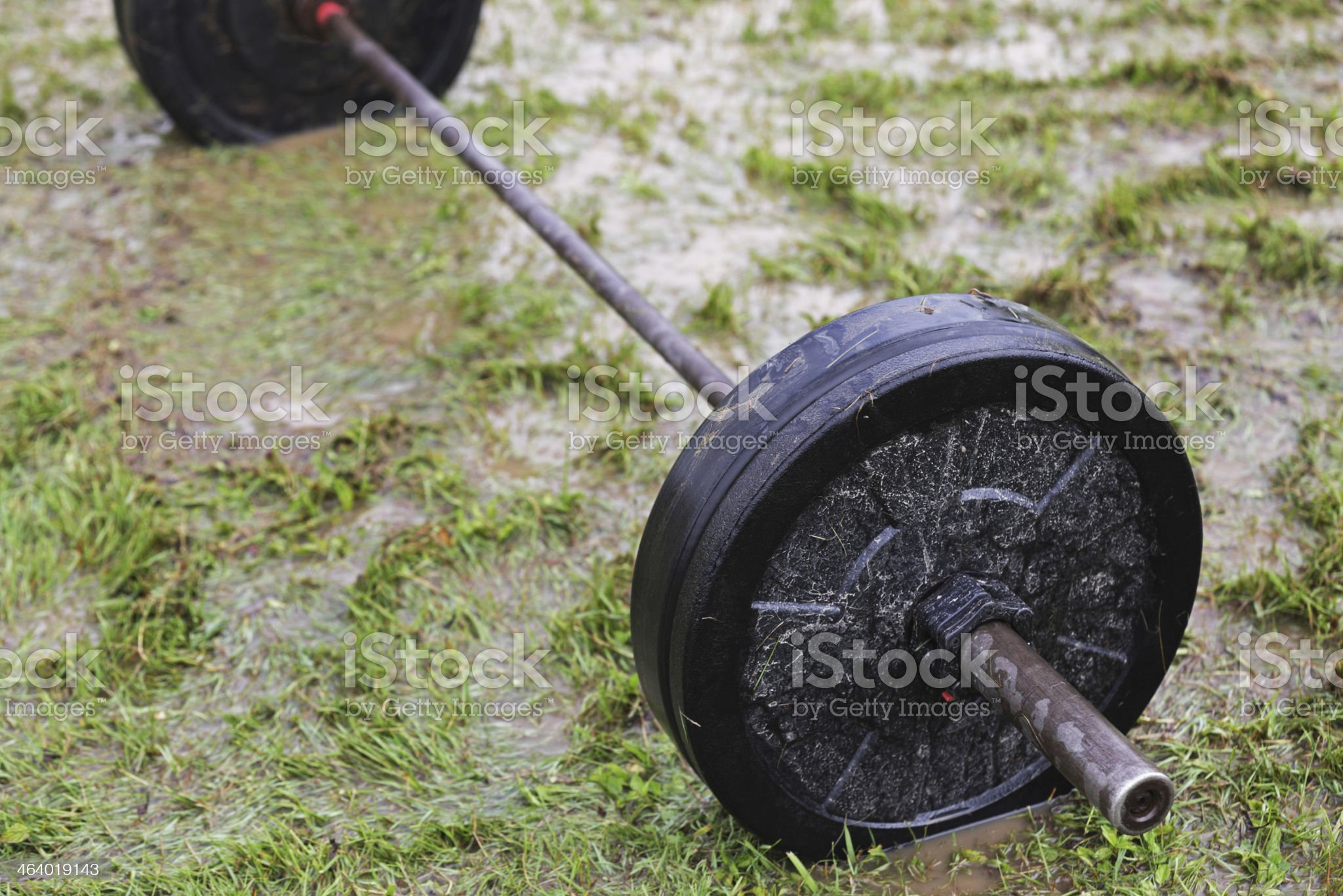 Drenched Muddy Barbell Weight Lifting Set royalty-free stock photo