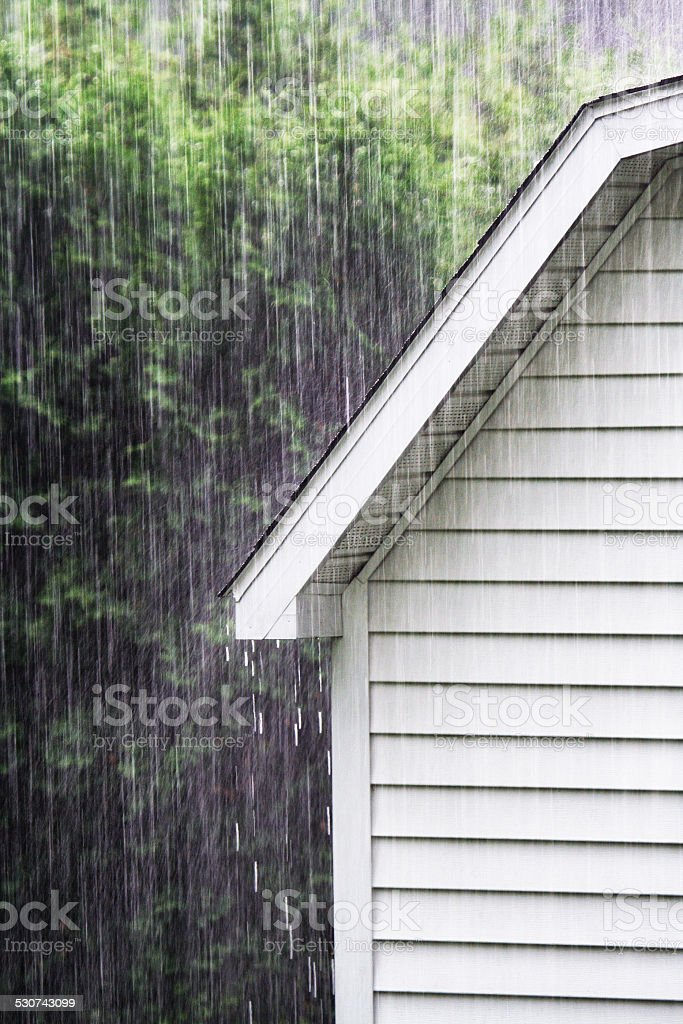 Drenching Rain Downpour On Old Backyard Shed stock photo