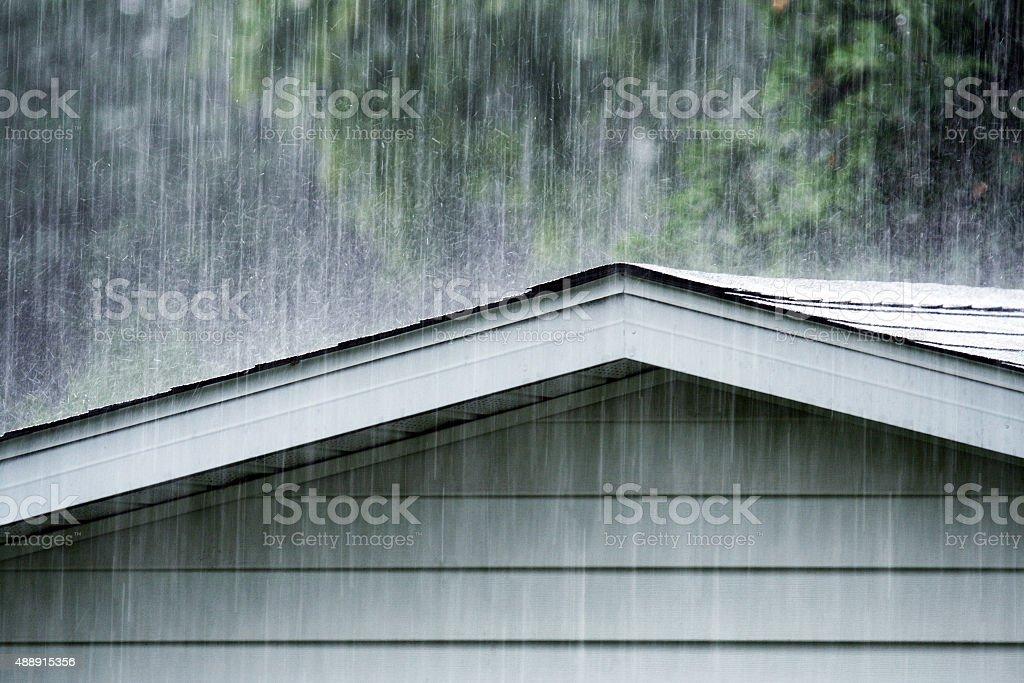 Drenching June summer rain storm downpour pounding and splattering...