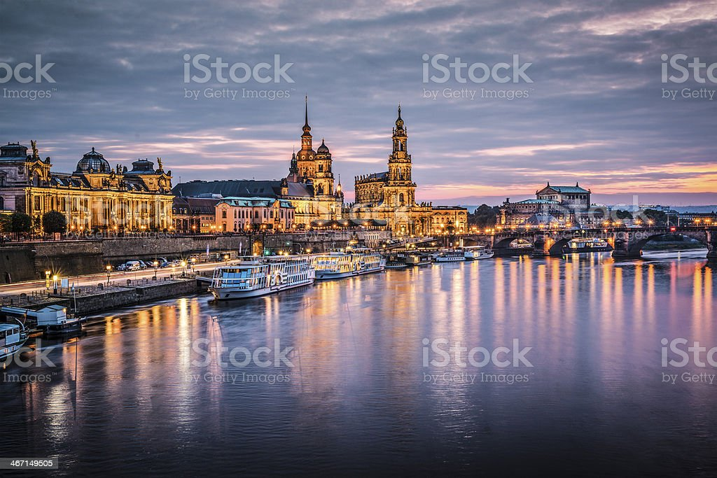 Dresden harbor at dusk with reflections of lights in water stock photo