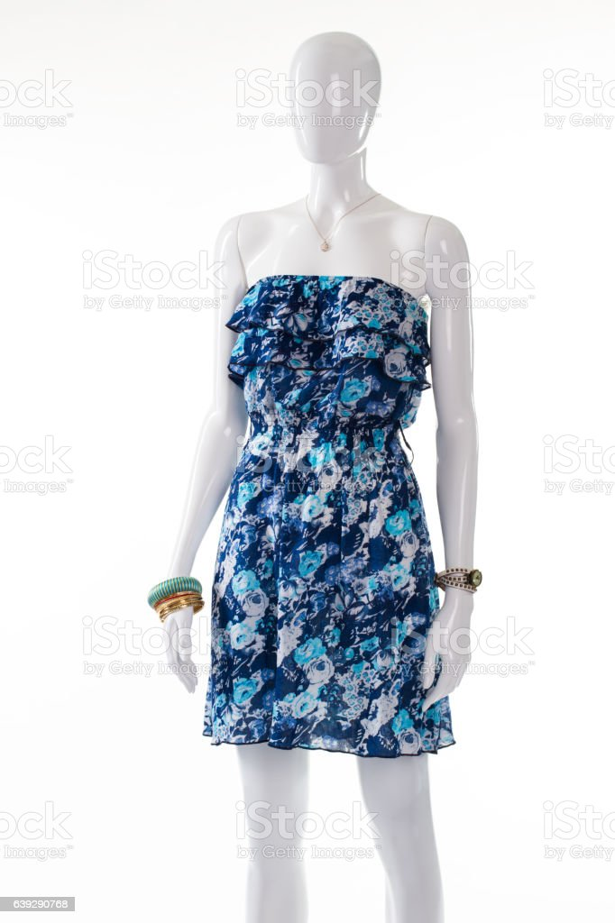 Dress and bracelets on mannequin. stock photo