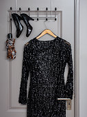 dress and shoes on a clothes rack inside door