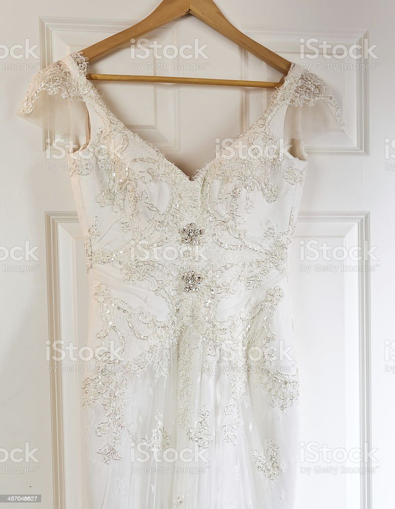 dress on a hanger in brides house stock photo