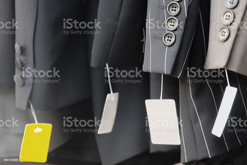 Dress suits and a yellow tag sale royalty-free stock photo