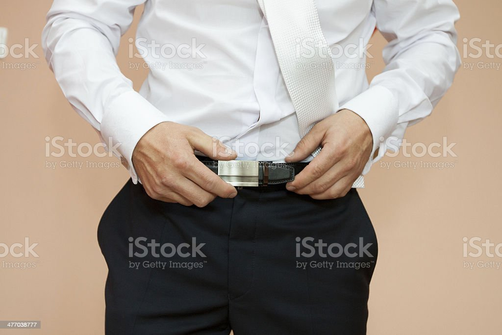 Dress up a belt with buckle royalty-free stock photo