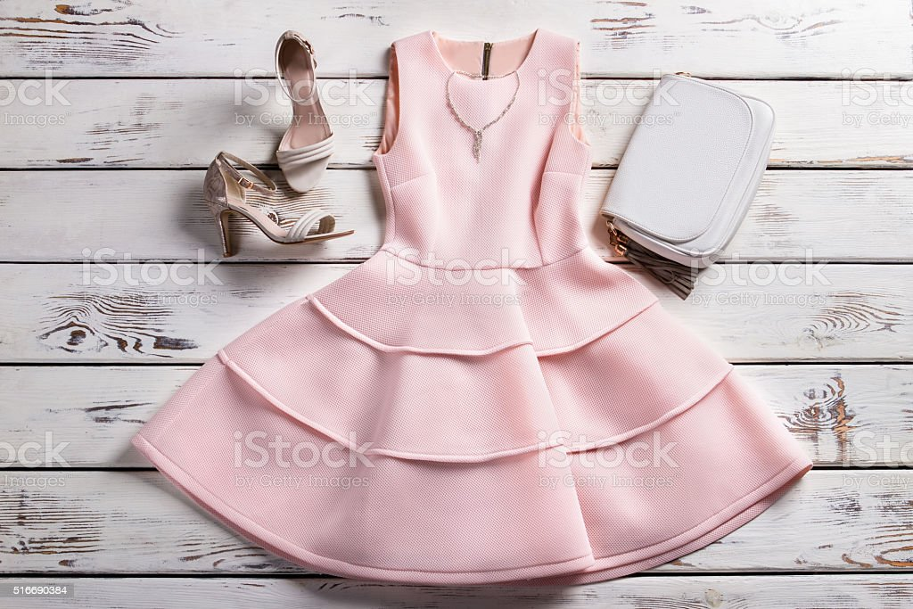 Dress with footwear and jewelry. stock photo