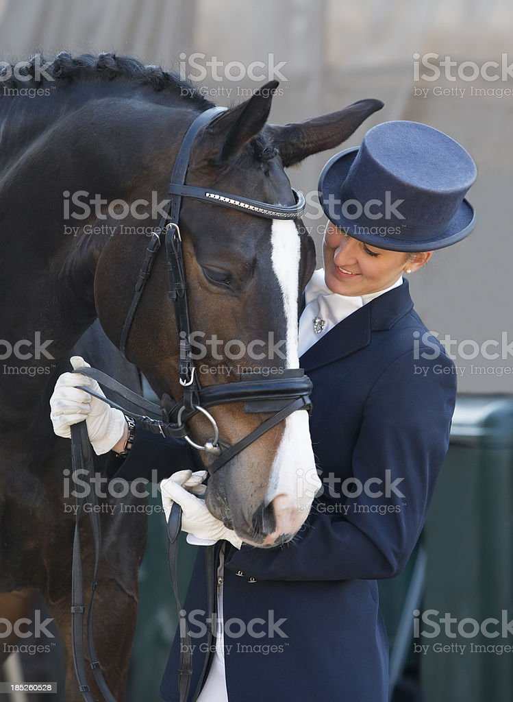 Dressage rider with her horse stock photo