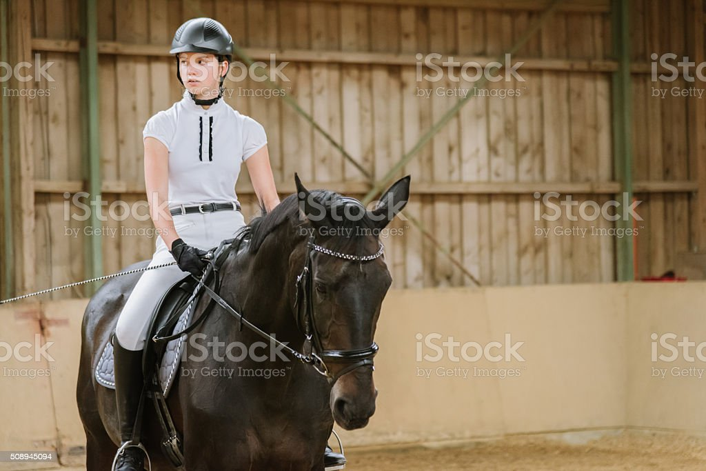 Dressage Riding Teenage Girl Equestrian Hall stock photo