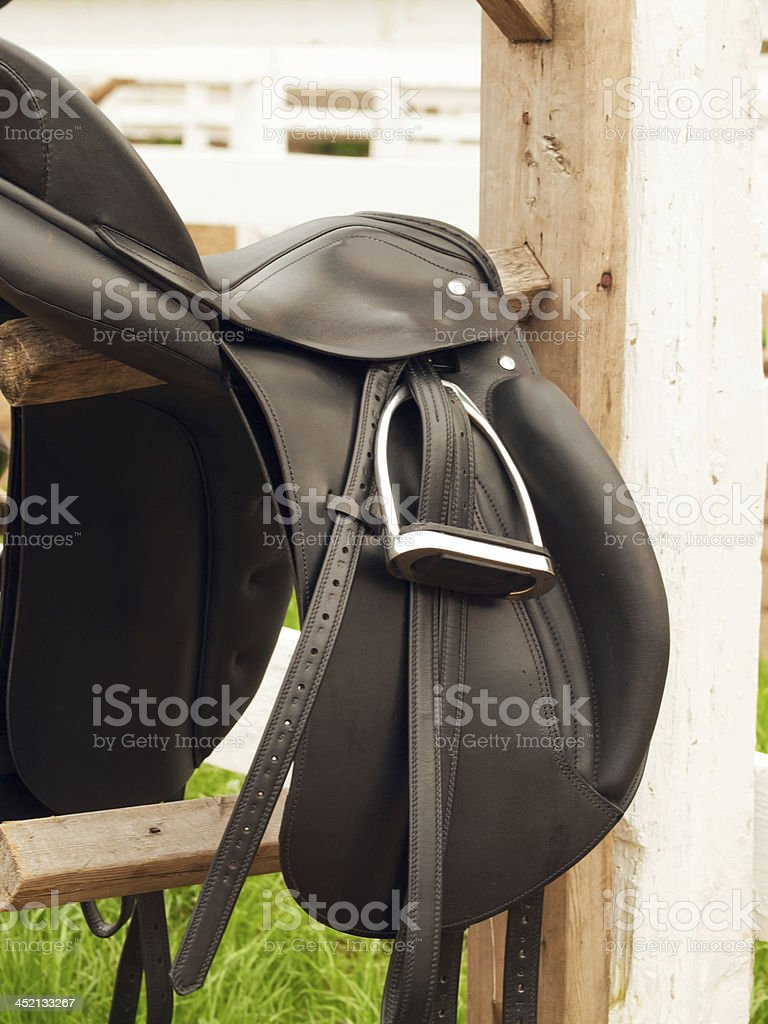dressage saddle at  the bracket. outdoor royalty-free stock photo
