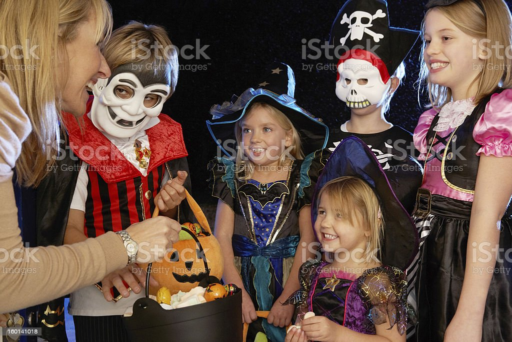 Dressed up Children trick or treating on Halloween stock photo