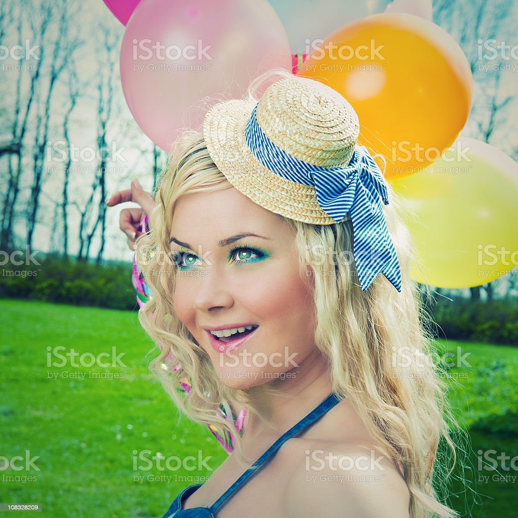 Dressed up woman with balloons royalty-free stock photo