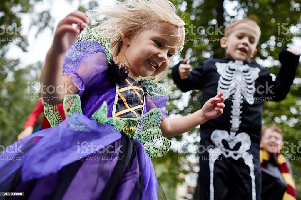 Dressed-up kids having fun on Halloween stock photo