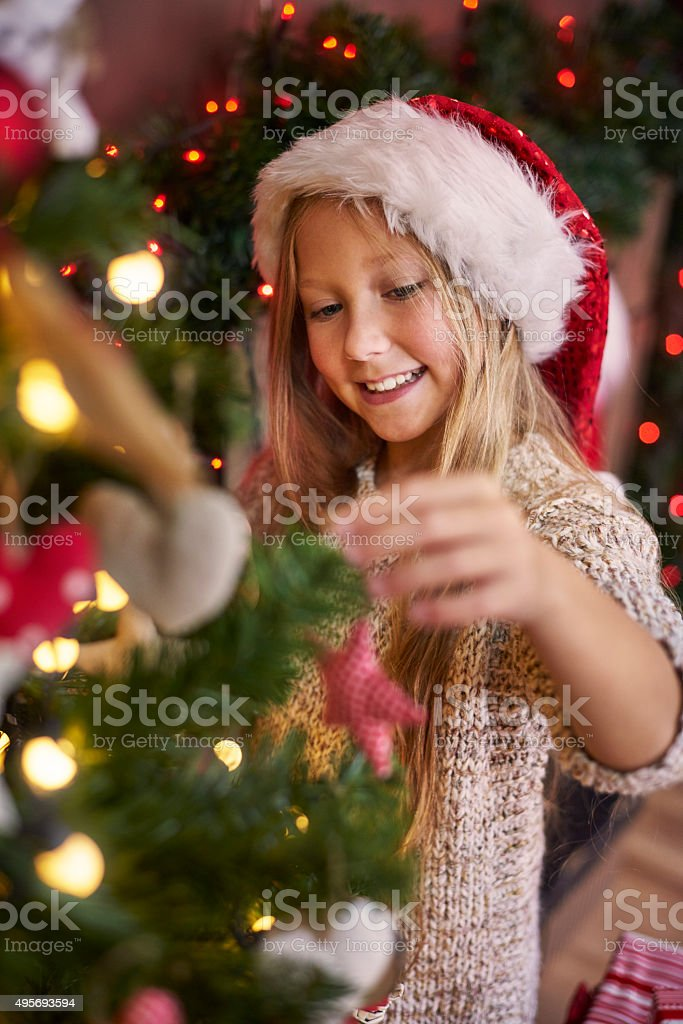 Dressing a Christmas tree is usually my duty stock photo