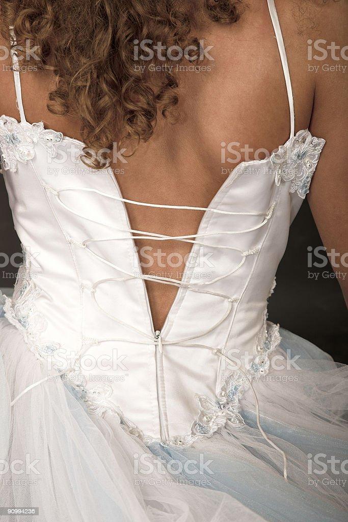 dressing bride stock photo