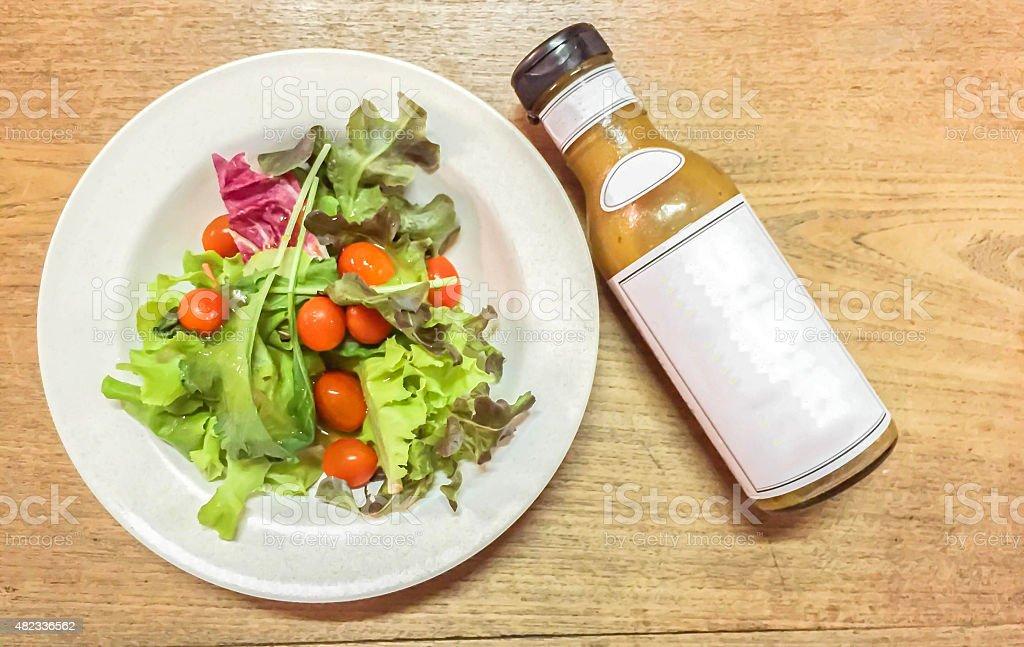 dressing salad and bowl of salad stock photo