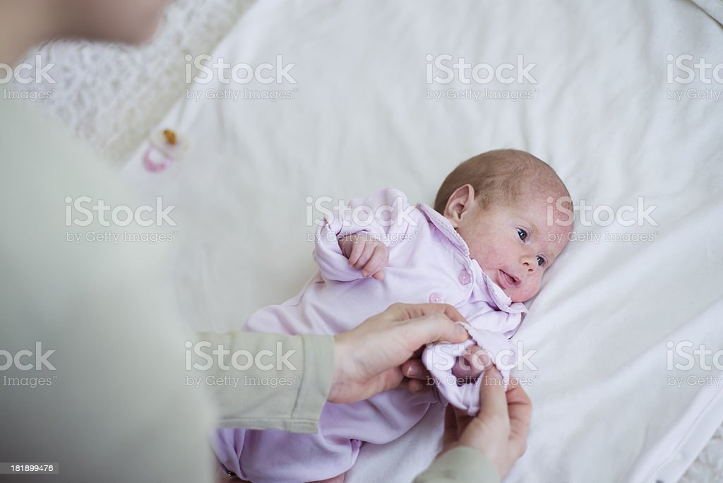 Dressing up a baby royalty-free stock photo